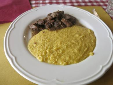Some kind of meat and polenta